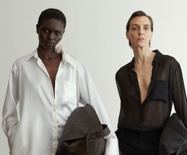 Two female models wearing black and white