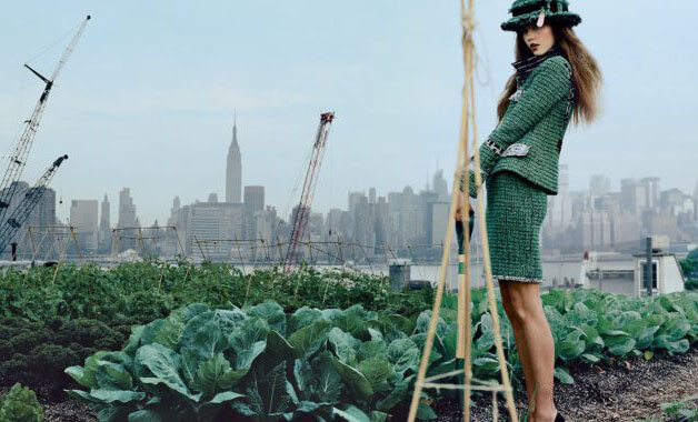 Sustainability in fashion woman in green field by the city